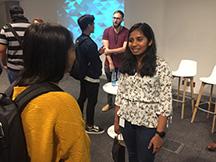 Riya Koshy chatting to students