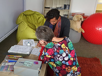 Occupational therapist working with a client